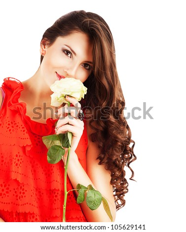 woman in red dress with long curly hair and white rose in hands on white background - stock photo