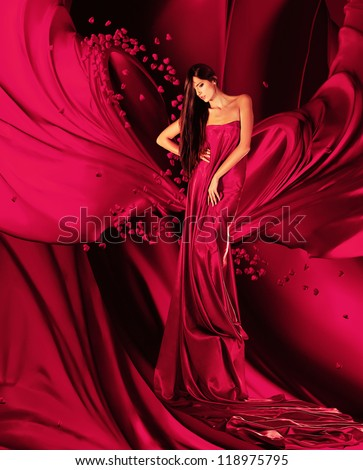 woman in red dress with long hair and hearts  on red drapery - stock photo