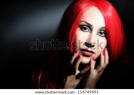Woman in red hair wig portrait. Redhead fashion model face
