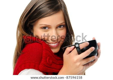 Woman in red knitted top holds soup bowl and looks at camera - stock photo