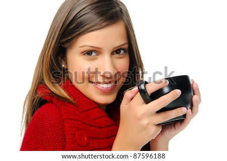 Woman in red knitted top holds soup bowl and looks at camera