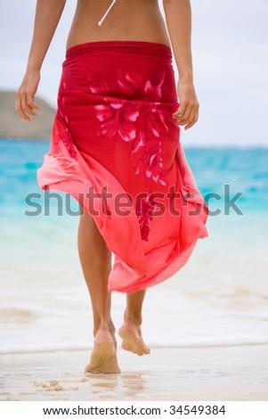 woman in red sarong on beautiful hawaii beach - stock photo