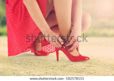woman in red skirt and summer sun  - stock photo