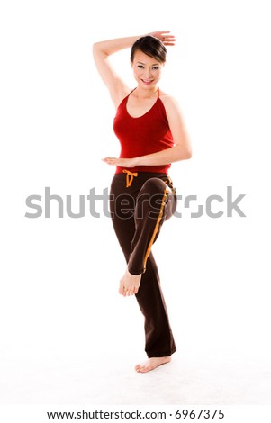 woman in red tank top in a self defense pose - stock photo