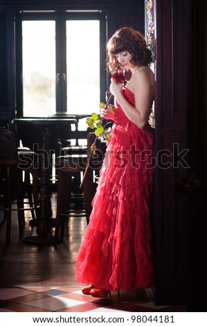 Woman in red with the rose - stock photo