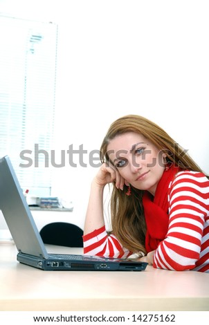 woman in red working on laptop at bright  office