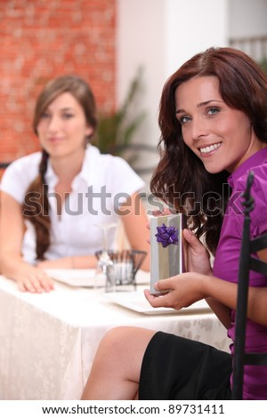 Woman in restaurant with birthday present