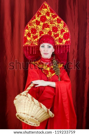 Woman in russian traditional clothes with basket