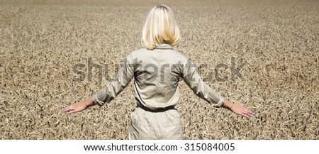 Woman in rye field sunny day close-up. - stock photo