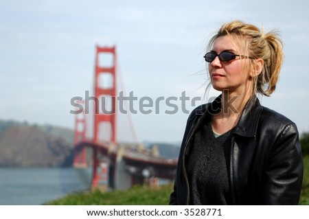 Woman in San Francisco with Golden Gate Bridge in the Background - stock photo