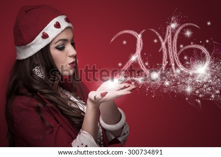 Woman in Santa costume blowing stars and made New year numbers 2016 - stock photo
