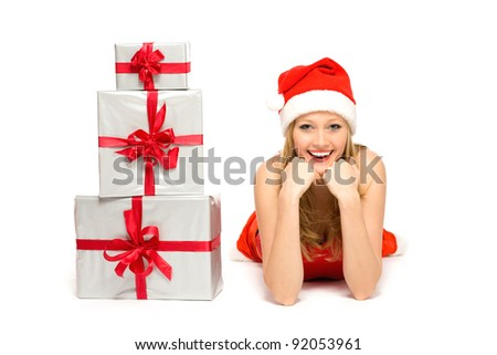 Woman in Santa hat lying down with gifts