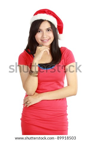 Woman in santa hat posing isolated on white background - stock photo