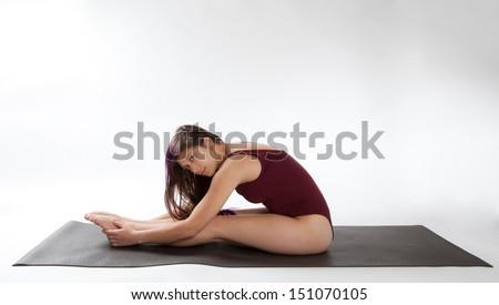 Woman in Seated Forward Bend - stock photo