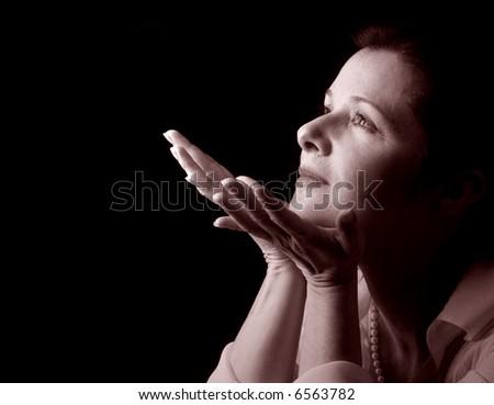 Woman in serene contemplation, in sepia tones - stock photo