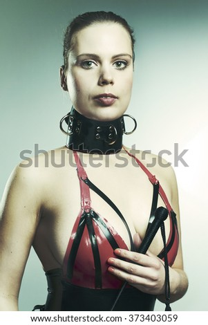 Woman in sexy latex apparel - stock photo