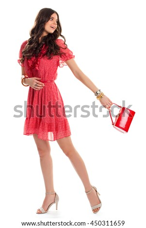Woman in short dress smiling. Red glossy bag and watch. Attractive clothes for young girls. New design of casual dress. - stock photo