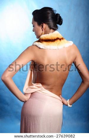 Woman in silk dress. Open back - stock photo