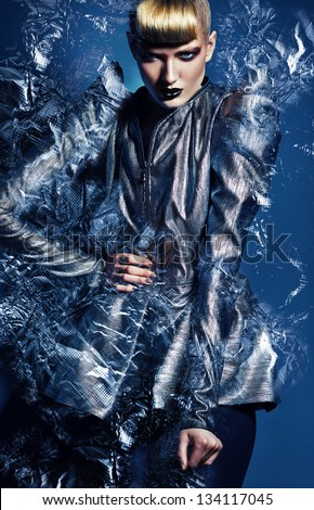 woman in silver jacket with silver abstract - stock photo