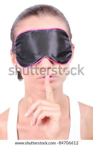 Woman in sleeping mask making a keep it quiet gesture - stock photo