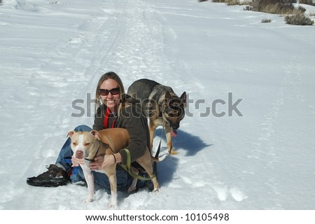 Woman in snow with dogs