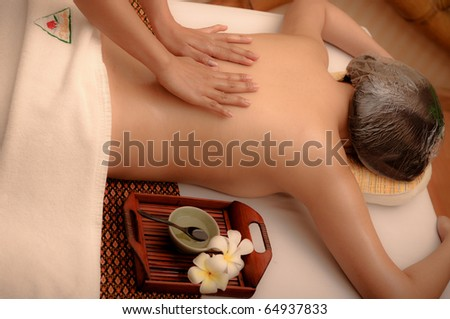 Woman in spa getting a deep tissue massage. - stock photo