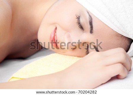 woman in spa on white towel with blond hair