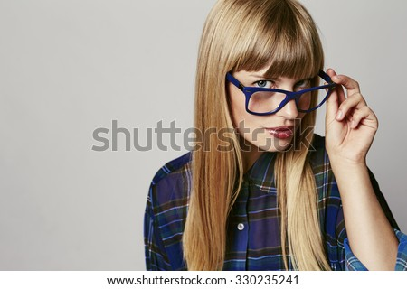 Woman in spectacles looking at camera