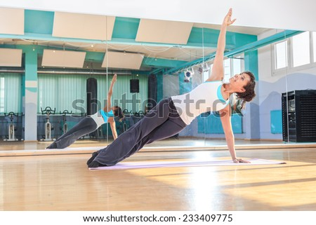 woman in sport dress at pilates and yoga exercise - stock photo