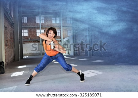 woman in sport dress dancing aerobics - stock photo