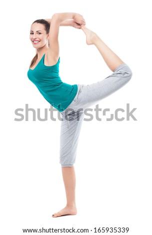 Woman in sportswear lifting leg in air  - stock photo
