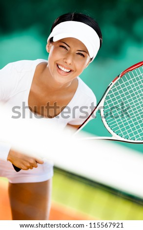 Woman in sportswear playing tennis. Competition - stock photo