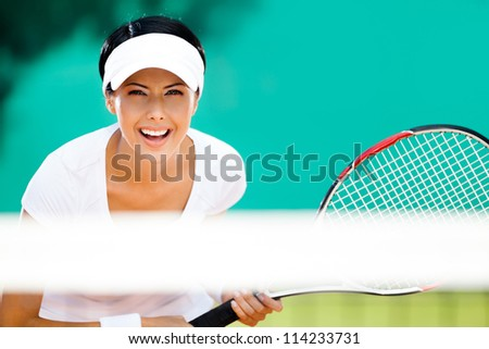 Woman in sportswear playing tennis. Tournament - stock photo