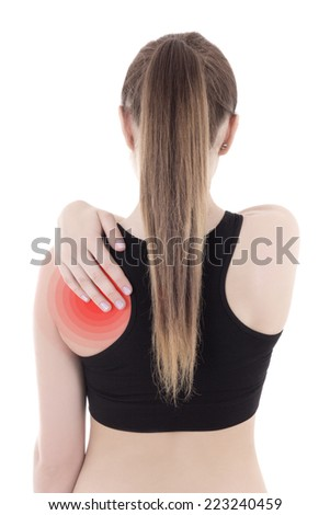 woman in sportswear with pain in her back isolated on white background - stock photo