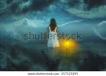 Woman in strange and surreal waters . Weird and fantasy - stock photo