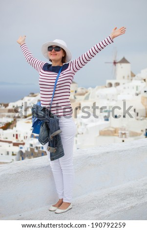 Woman in striped t-short in Santorini island, Greece - stock photo