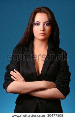 woman in suit isolated on blue background - stock photo