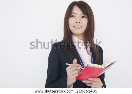 Woman In Suits With A Notebook