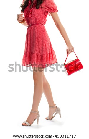 Woman in summer dress. Young girl on heels. Casual dress with short sleeves. Shopping went well. - stock photo
