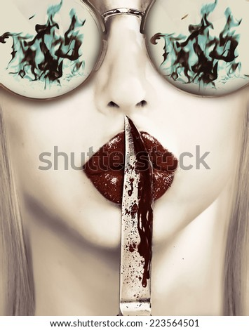 woman in sunglasses with bloody knife on lips - stock photo
