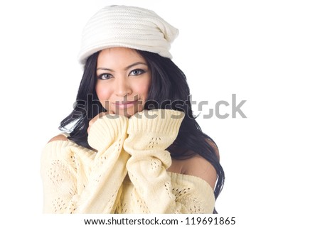 Woman in sweater with gloves and hat smiling  on white  background - stock photo