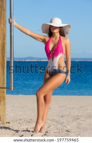 woman in swimsuit on beach vacation or summer holiday in Mallorca or majorca - stock photo