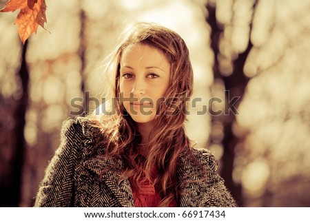 Woman in the autumn park, retro colors - stock photo