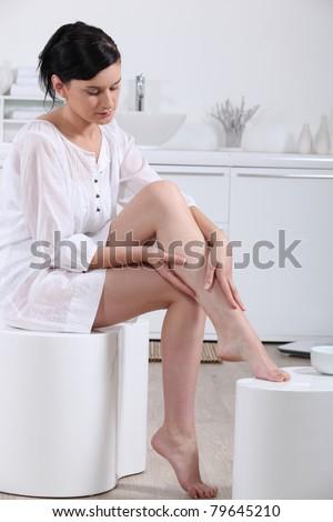 woman in the bathroom - stock photo