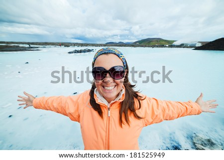 Woman in The Blue Lagoon geothermal bath resort in Iceland - stock photo