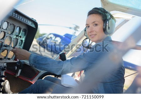 woman in the cabin of the helicopter before flying