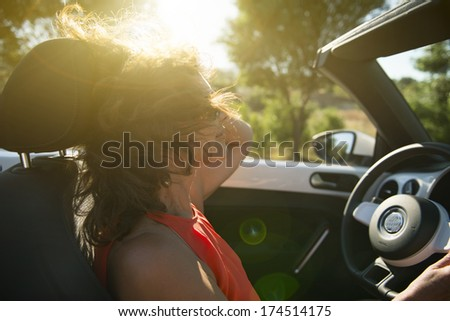 Woman in the car. driving pleasure - stock photo