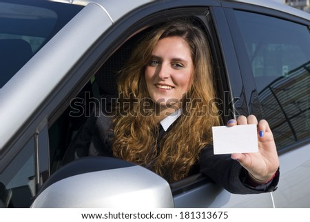 Woman in the car with empty tocket - stock photo
