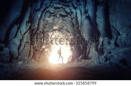Woman in the cave - stock photo