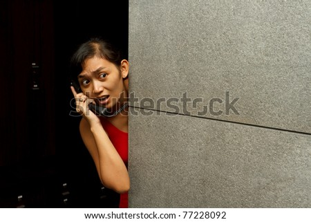 woman in the dark make an emergency phone call, scare of something - stock photo